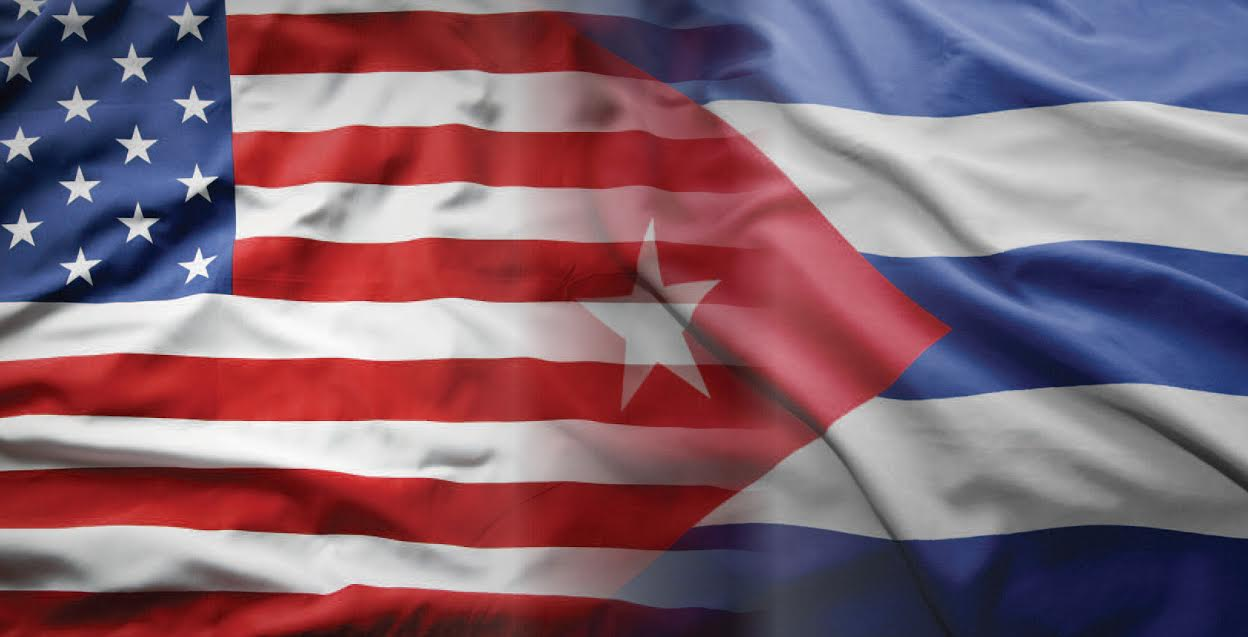 An image of the American flag on the left blending into the Cuban flag on the right.