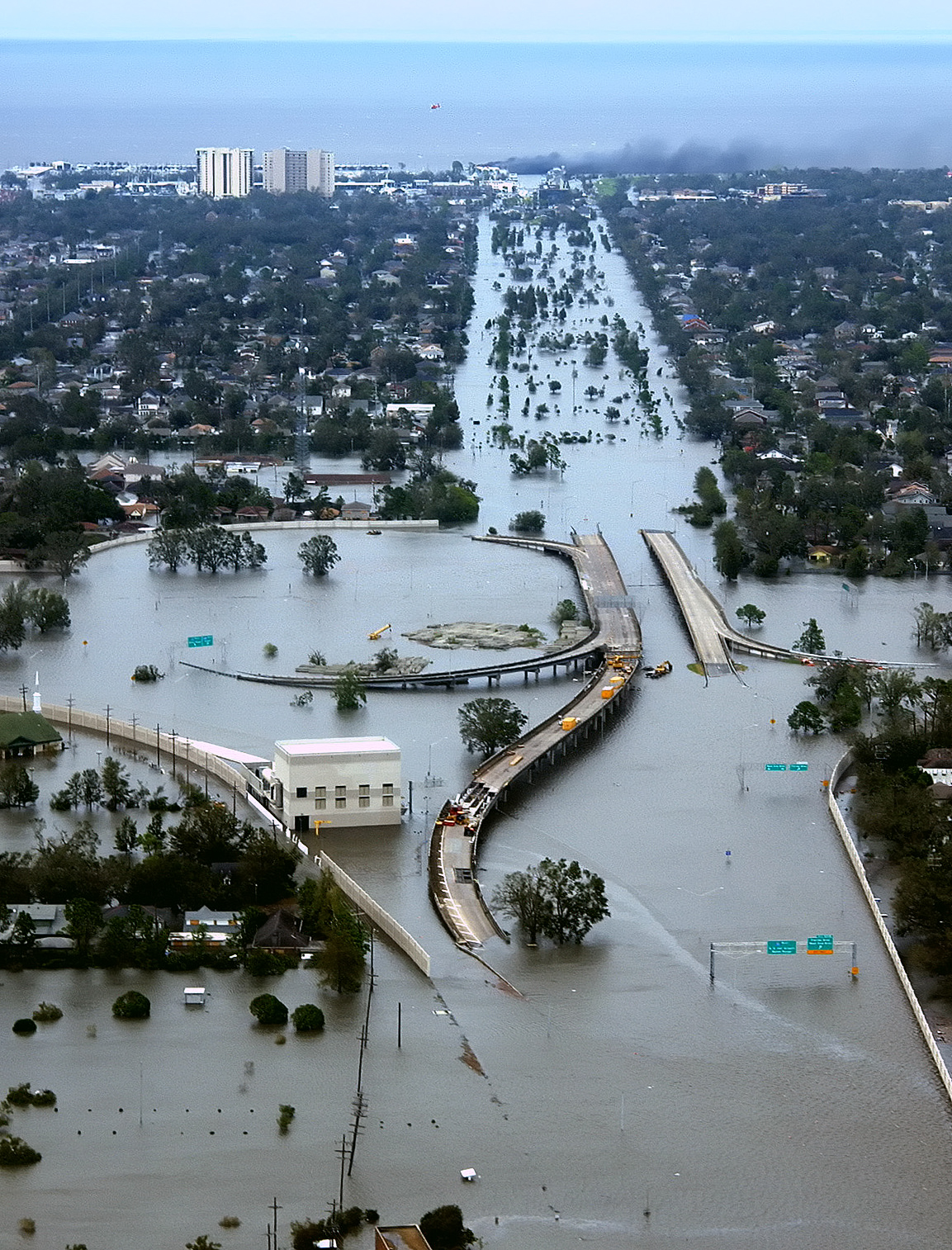 This image shows the city of New Orleans, LA flooded after Hurricane Katrina, particularly it shows high ways and government buildings under water.