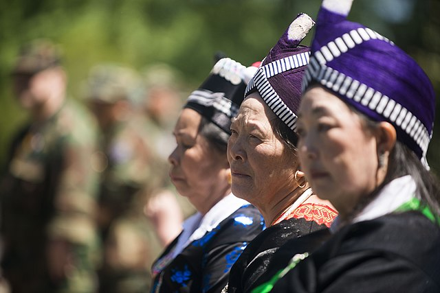 3 individuals are featured at at a ceremony honoring hmong and lao combat veterans