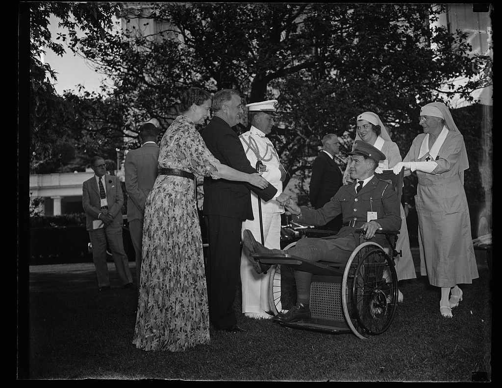 President and Mrs. Roosevelt entertaining disabled veterans at a garden party. https://www.loc.gov/item/2016883671/.