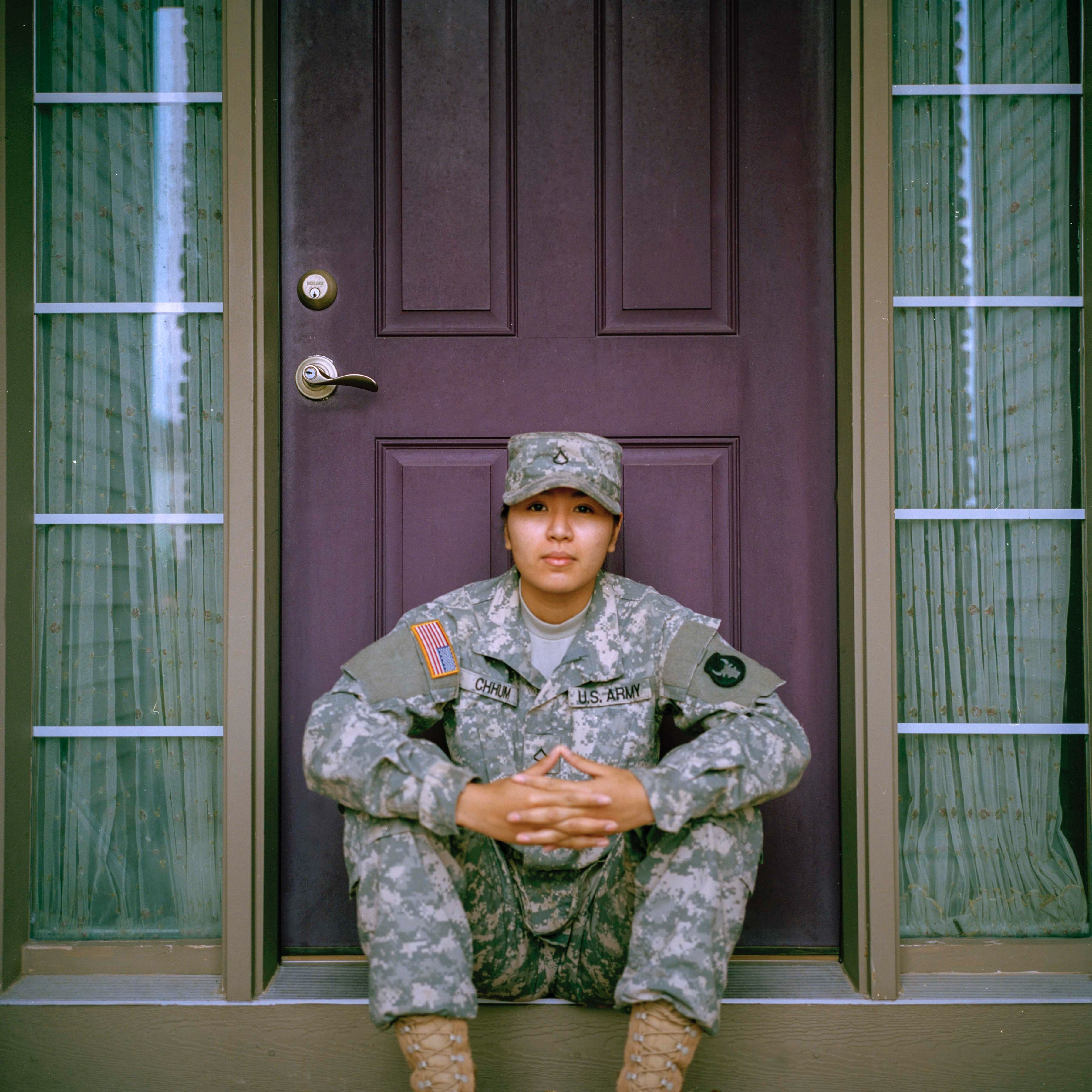 A U.S. Soldier sits in front of a door