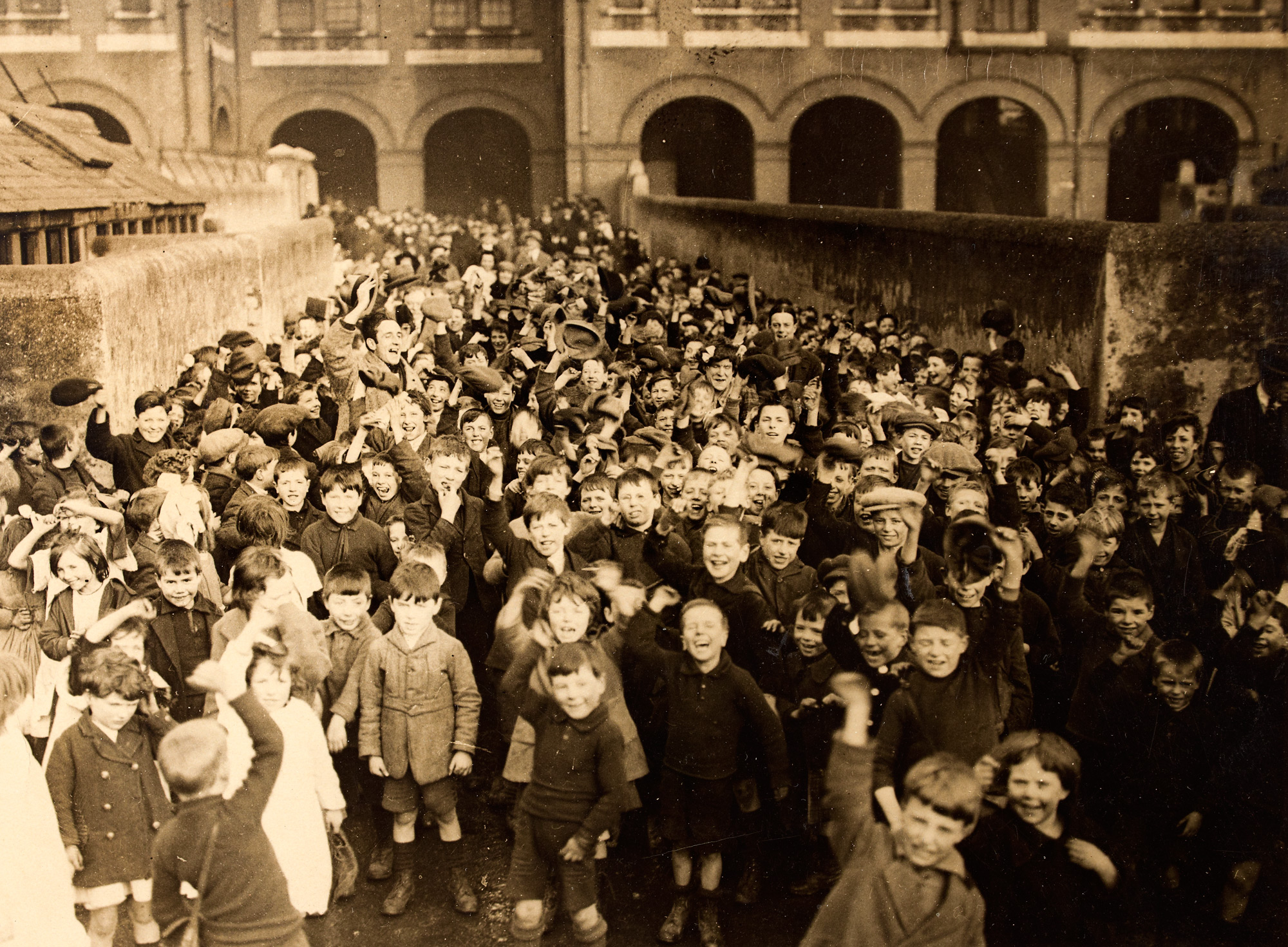 An old photo of a large group of children celebrating