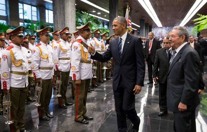 Former president Barak Obama greets cuban military individuals