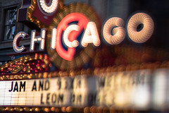 A marquee with 'Chicago' in bright neon lights above it
