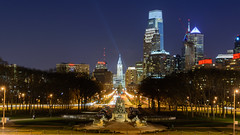 The Philadelphia George Washington monument the Philadelphia skyline behind it
