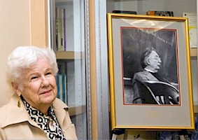 Image of Marion G. Merrill, next to a photograph of her husband Samuel Merrill