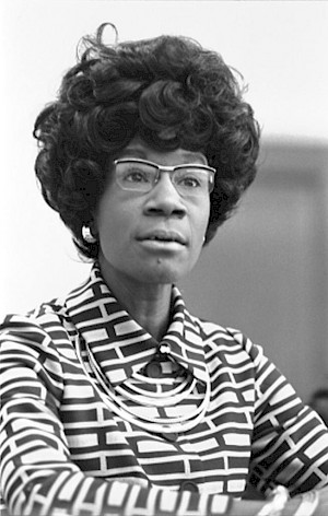 A black and white photograph of Shirley Chisholm