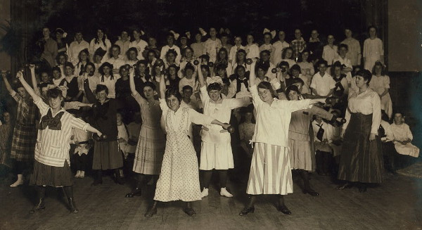 A large group of young women lifting hand weights together