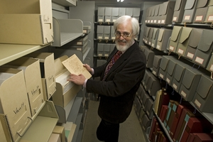 An archivist looking through some archived materials