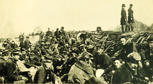 An 1863 photograph of Civil War soldiers huddled in trenches