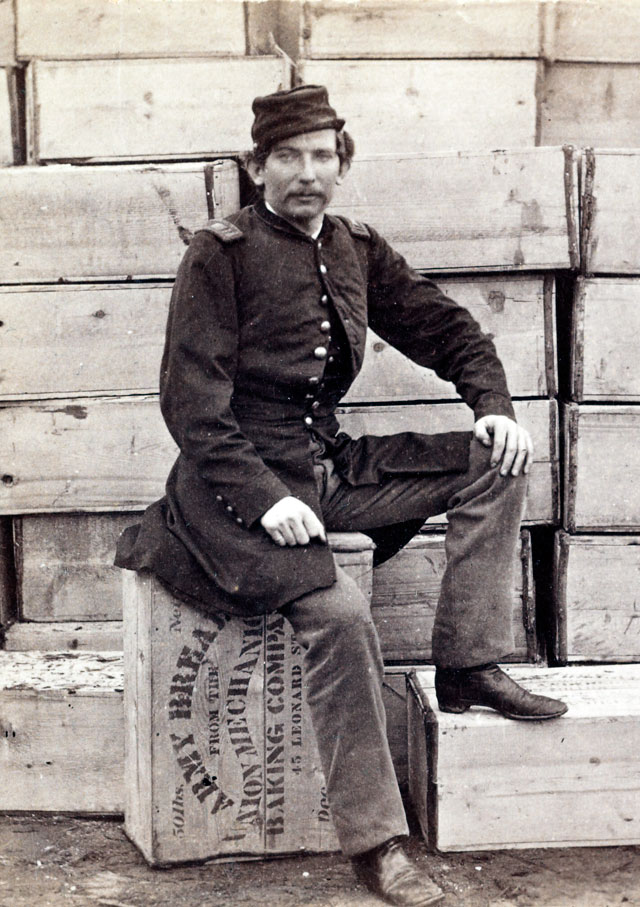 A Union soldier sitting on a hardtack box